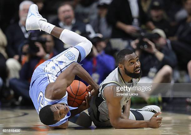 Kenny Williams of the North Carolina Tar Heels and Keyshawn Woods of the Wake Forest Demon Deacons battle for a loose ball during their game at LJVM...
