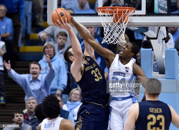 Kenny Williams of the North Carolina Tar Heels blocks a shot by John Mooney of the Notre Dame Fighting Irish during their game at the Dean Smith...