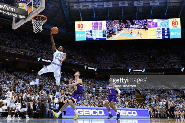 Kenny Williams of the North Carolina Tar Heels drives past Hunter Vick of the Tennessee Tech Golden Eagles during the second half of their game at...