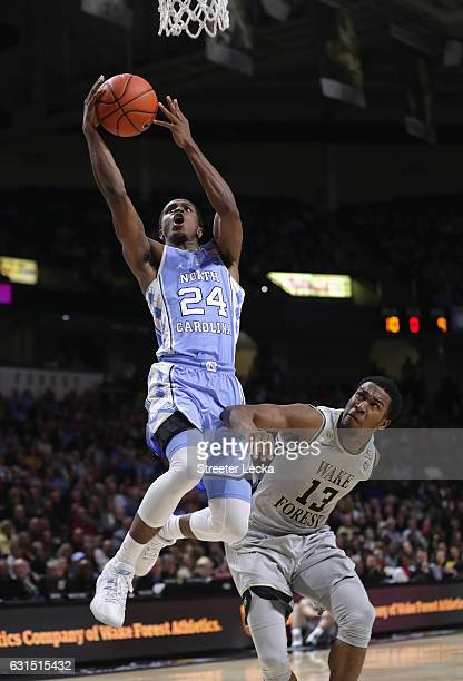 Kenny Williams of the North Carolina Tar Heels drives to the basket against Bryant Crawford of the Wake Forest Demon Deacons during their game at...