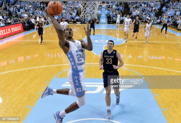 Kenny Williams of the North Carolina Tar Heels drives to the basket as John Mooney of the Notre Dame Fighting Irish looks on during their game at the...