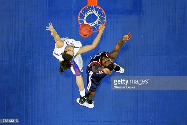Kenny Williams of the Ole Miss Rebels fights for a rebound with Joakim Noah of the Florida Gators during their semifinal game in the Southeastern...