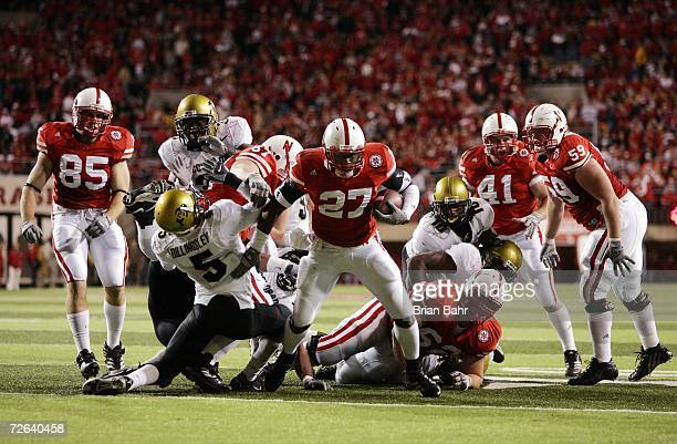 Kenny Wilson of the Nebraska Cornhuskers breaks through the defensive line past safety JJ Billingsley of the Colorado Buffaloes for a touchdown in...