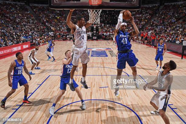 Kenny Wooten of the New York Knicks recovers the rebound during the game against Aubrey Dawkins of the New Orleans Pelicans during Day 1 of the 2019...