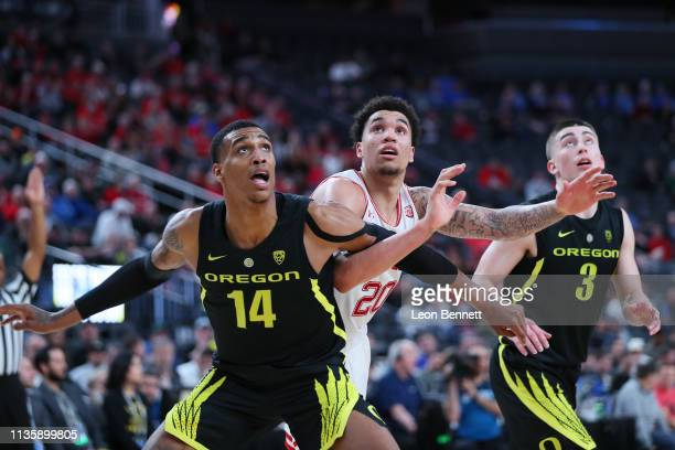 Kenny Wooten of the Oregon Ducks battling for position against Timmy Allen of the Utah Utes during a quarterfinal game of the Pac12 basketball...