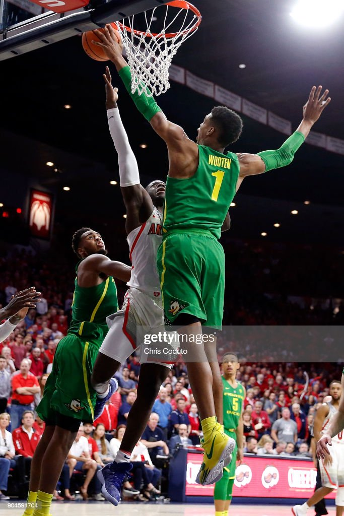 Kenny Wooten #1 of the Oregon Ducks blocks a shot by Rawle Alkins #1 of the Arizona Wildcats during the second half of the college basketball game at McKale Center on January 13, 2018 in Tucson, Arizona. The Wildcats beat the Ducks 90-83.