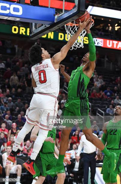 Kenny Wooten of the Oregon Ducks blocks a shot by Sedrick Barefield of the Utah Utes as time expires in their quarterfinal game of the Pac12...