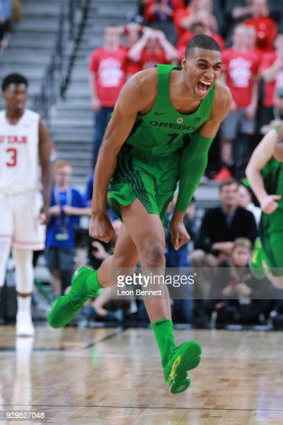 Kenny Wooten of the Oregon Ducks celebrates after block shot against the Utah Utes during a quarterfinal game of the Pac12 basketball tournament at...