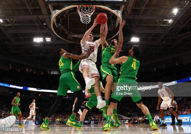 Kenny Wooten of the Oregon Ducks Nate Reuvers of the Wisconsin Badgers Paul White of the Oregon Ducks and Ehab Amin of the Oregon Ducks in the second...