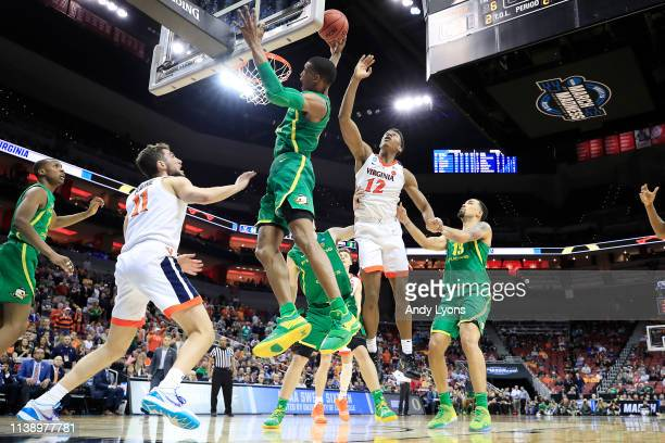 Kenny Wooten of the Oregon Ducks rebounds the ball against the Virginia Cavaliers during the second half of the 2019 NCAA Men's Basketball Tournament...