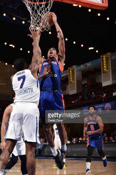 Kenny Wooten of the Westchester Knicks shoots against Haywood Highsmith of the Delaware Blue Coats at the Westchester County Center on January 07...
