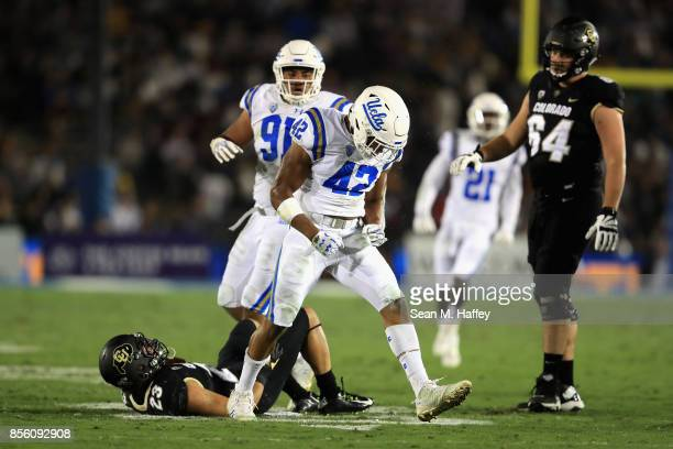 Kenny Young and Jacob TuiotiMariner of the UCLA Bruins celebrate a tackle of Phillip Lindsay of the Colorado Buffaloes during the first half of a...