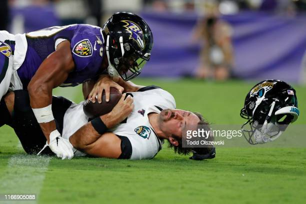 Kenny Young of the Baltimore Ravens sacks Gardner Minshew of the Jacksonville Jaguars in the first half of a preseason game at M&T Bank Stadium on...