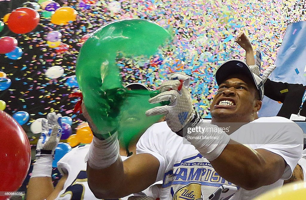 Kenny Young #42 of the UCLA Bruins pops a ballon after a 40-35 win against the Kansas State Wildcats during the Valero Alamo Bowl at Alamodome on January 2, 2015 in San Antonio, Texas.