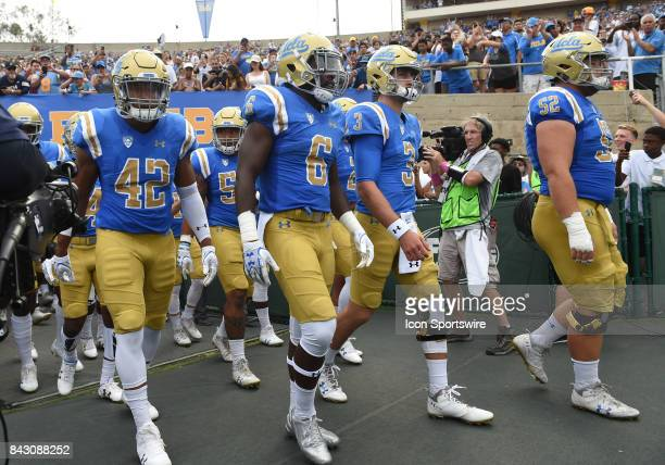 Kenny Young UCLA Stephen Johnson UCLA Josh Rosen and UCLA Scott Quessenberry take the field during a college football game between the Texas AM...