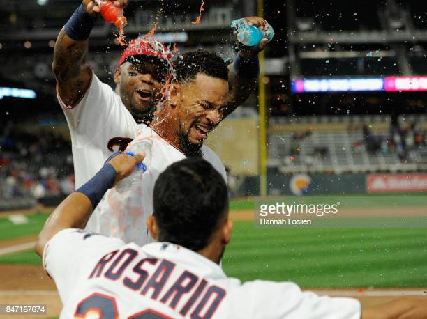 Kennys Vargas and Eddie Rosario of the Minnesota Twins congratulates teammate Byron Buxton on a walkoff solo home run against the Toronto Blue Jays...