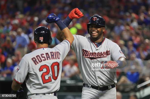 Kennys Vargas of the Minnesota Twins celebrates his home run with Eddie Rosario in the fourth inning against the Texas Rangers at Globe Life Park in...