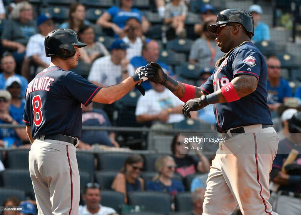Kennys Vargas #19 of the Minnesota Twins celebrates his two-run home run with Zack Granite #8 in the ninth inning against the Kansas City Royals at Kauffman Stadium on September 10, 2017 in Kansas City, Missouri.