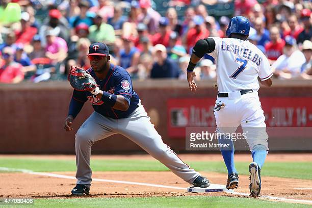 Kennys Vargas of the Minnesota Twins makes the out against Delino DeShields of the Texas Rangers in the first inning at Globe Life Park in Arlington...