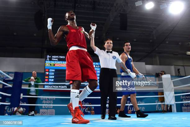 Keno Machado of Brazil fights agains Farid Douibi of Algeria in Men's Middle Gold Medal Bout during day 11 of Buenos Aires 2018 youth Olympic Games...