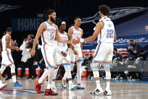 Kenrich Williams and Isaiah Roby of the Oklahoma City Thunder hi-five during the game against the Chicago Bulls on January 15, 2021 at Chesapeake...