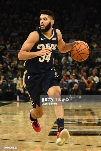 Kenrich Williams of the New Orleans Pelicans handles the ball during a game against the Milwaukee Bucks at Fiserv Forum on December 11 2019 in...