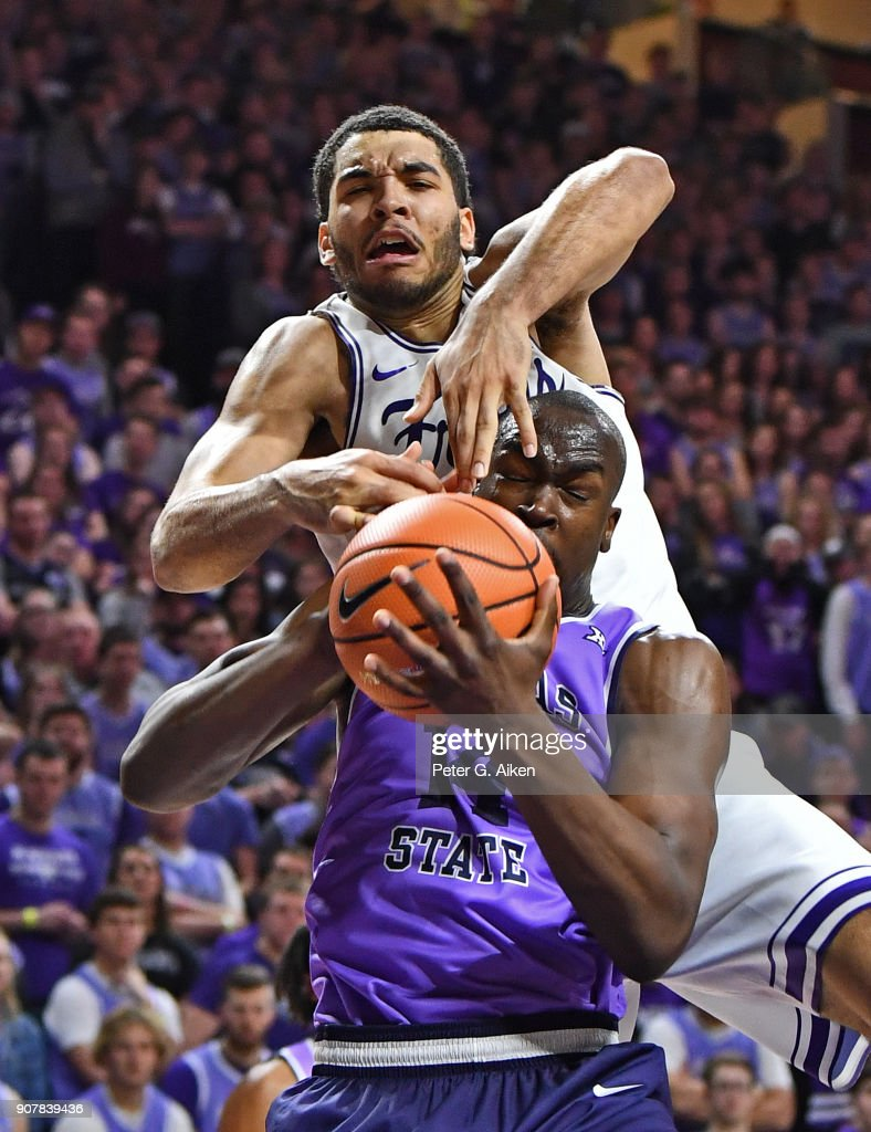 Kenrich Williams #34 of the TCU Horned Frogs comes over the top of Makol Mawien #14 of the Kansas State Wildcats for a foul during the second half on January 20, 2018 at Bramlage Coliseum in Manhattan, Kansas.