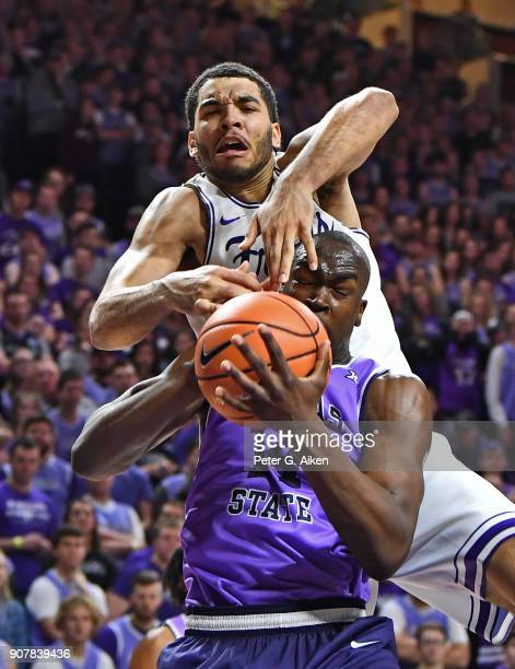 Kenrich Williams of the TCU Horned Frogs comes over the top of Makol Mawien of the Kansas State Wildcats for a foul during the second half on January...