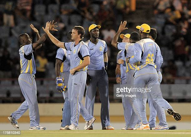 Kenroy Peters gives Albie Morkel of St Lucia Zouks a high five during the Tenth Match of the Caribbean Premier League between Barbados Tridents v St...