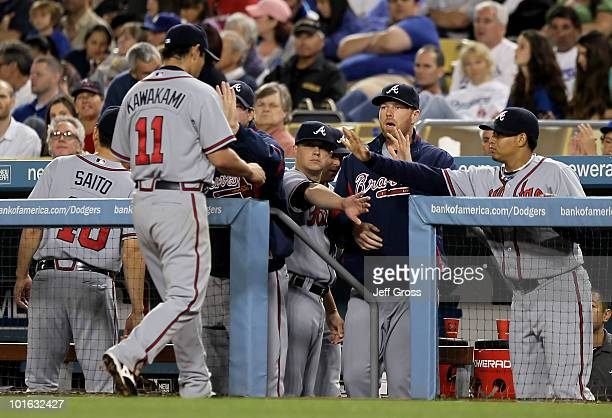 Kenshin Kawakami of the Atlanta Braves receives high fives from the dugout after coming out in the seventh inning against the Los Angeles Dodgers at...