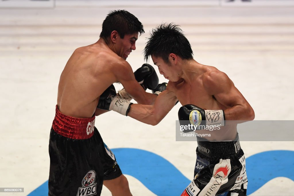 Kenshiro Teraji of Japan (R) and Pedro Guevara of Mexico exchange punches during their WBC Light Flyweight Title Bout at Ryogoku Kokugikan on October 22, 2017 in Tokyo, Japan.