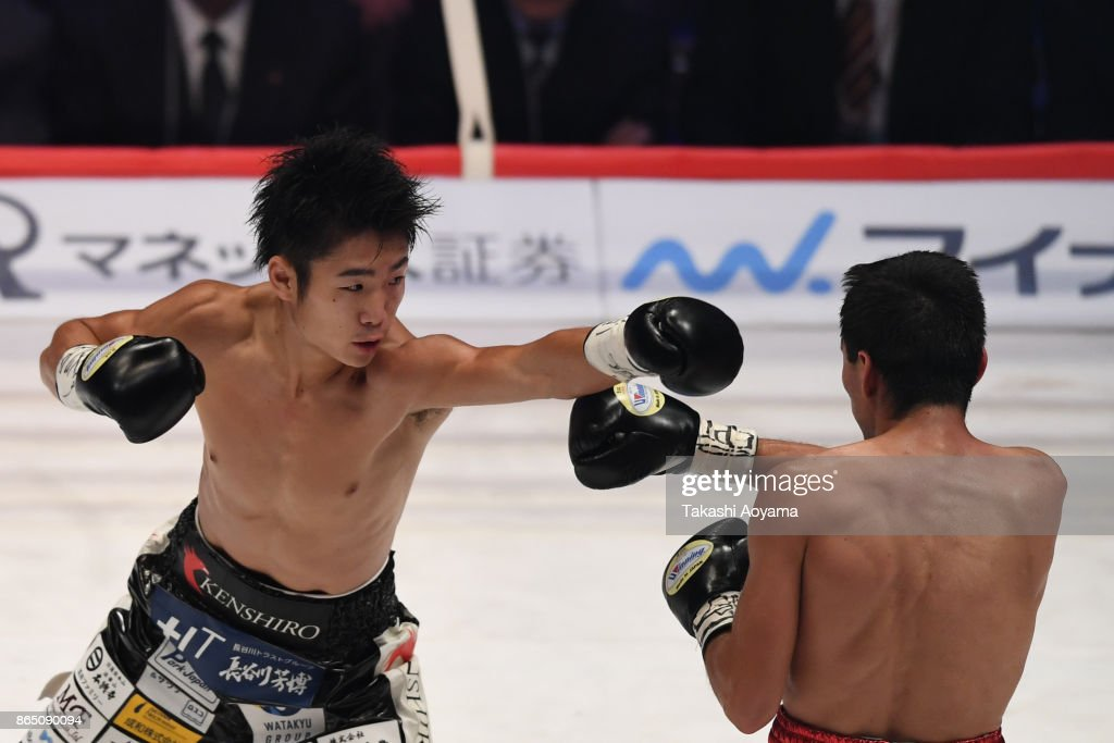 Kenshiro Teraji of Japan (L) and Pedro Guevara of Mexico exchange punches during their WBC Light Flyweight Title Bout at Ryogoku Kokugikan on October 22, 2017 in Tokyo, Japan.