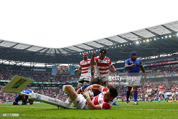 Kensuke Hatakeyama of Japan celebrates the try scored by Akihito Yamada during the 2015 Rugby World Cup Pool B match between Samoa and Japan at...