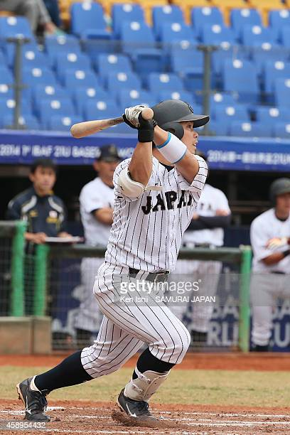 Kensuke Kondo of Japan bats in the bottom of the first inning against South Korea during the IBAF 21U Baseball World Cup Group C game between Japan...