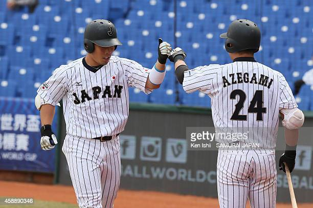 Kensuke Kondo of Japan celebrates with Sho Azegami after hitting a home run in the bottom of the third inning against Czech during the IBAF 21U...