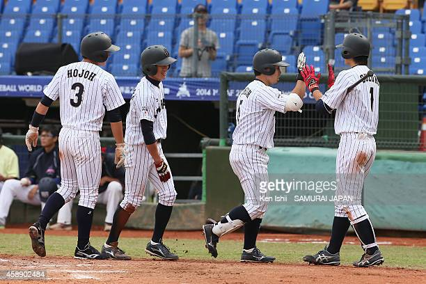 Kensuke Kondo of Japan celebrates with teammate after his hitting home run in the bottom of the third inning against Czech during the IBAF 21U...