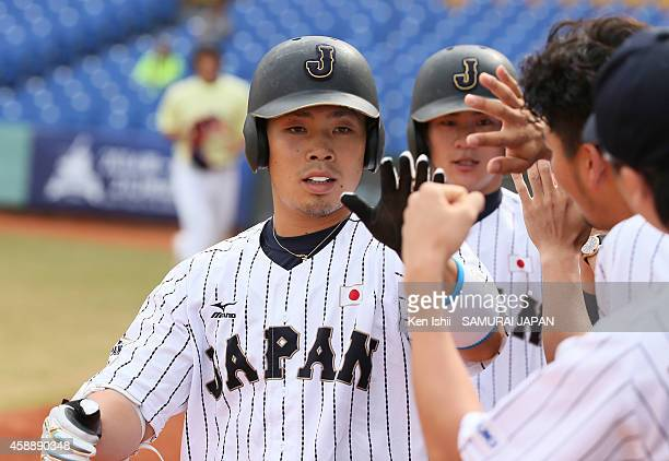 Kensuke Kondo of Japan celebrates with teammate after hitting a home run in the bottom of the third inning against Czech during the IBAF 21U Baseball...