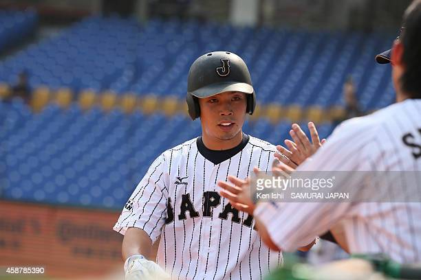 Kensuke Kondo of Japan celebrates with teammate after scoring in the bottom of the first inning against Nicaragua during the IBAF 21U Baseball World...