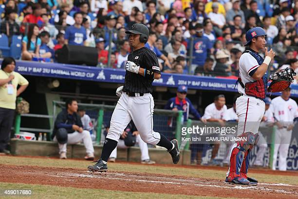 Kensuke Kondo of Japan crosses home plate to score a run in the top of the seventh inning against Chinese Taipei during the IBAF 21U Baseball World...