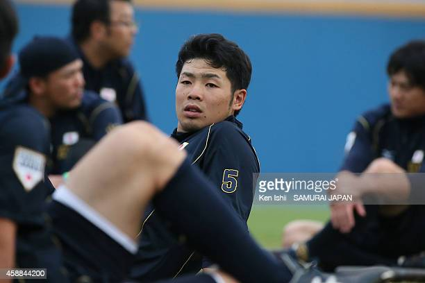 Kensuke Kondo of Japan stretches during a Japan team training session at Taichung Baseball Stadium on November 12 2014 in Taichung Taiwan