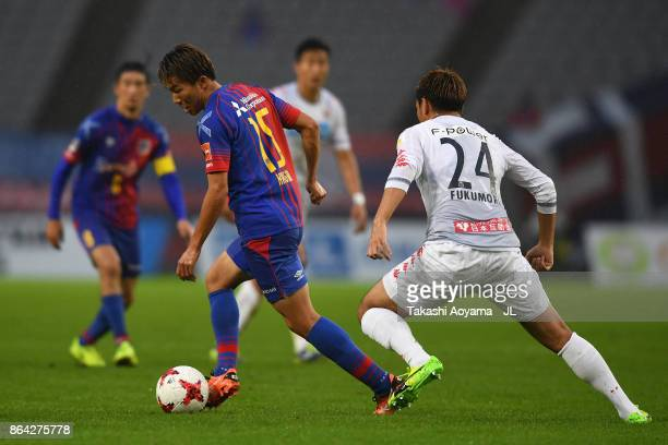 Kensuke Nagai of FC Tokyo and Akito Fukumori of Consadole Sapporo compete for the ball during the JLeague J1 match between FC Tokyo and Consadole...