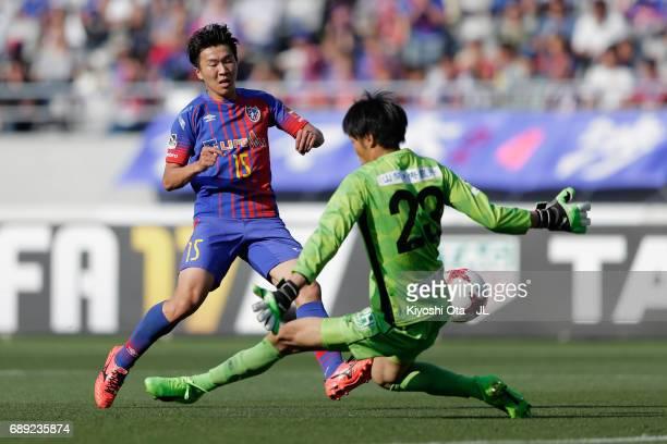 Kensuke Nagai of FC Tokyo and Hiroki Oka of Ventforet Kofu compete for the ball during the JLeague J1 match between FC Tokyo and Ventforet Kofu at...