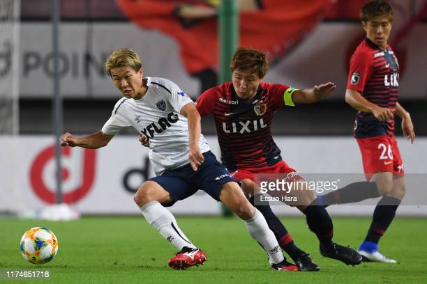 Kensuke Nagai of FC Tokyo and Kento Misao of Kashima Antlers compete for the ball during the J.League J1 match between Kashima Antlers and FC Tokyo...