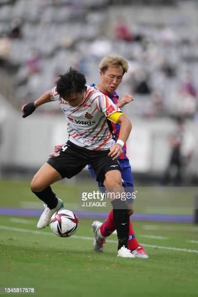 Kensuke NAGAI of FC Tokyo and NG0 battle for the ball during the J.League Levain Cup Semi Final second leg match between FC Tokyo and Nagoya Grampus...