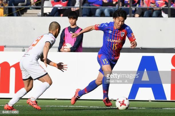 Kensuke Nagai of FC Tokyo and Ryo Okui of Omiya Ardija compete for the ball during the J.League J1 match between FC Tokyo and Omiya Ardija at...