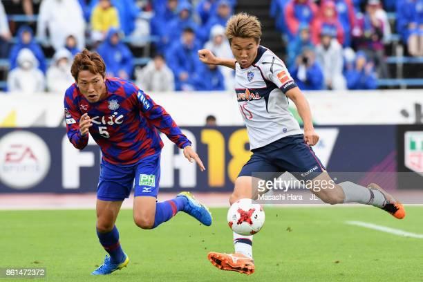 Kensuke Nagai of FC Tokyo and Ryo Shinzato of Ventforet Kofu compete for the ball during the JLeague J1 match between Ventforet Kofu and FC Tokyo at...
