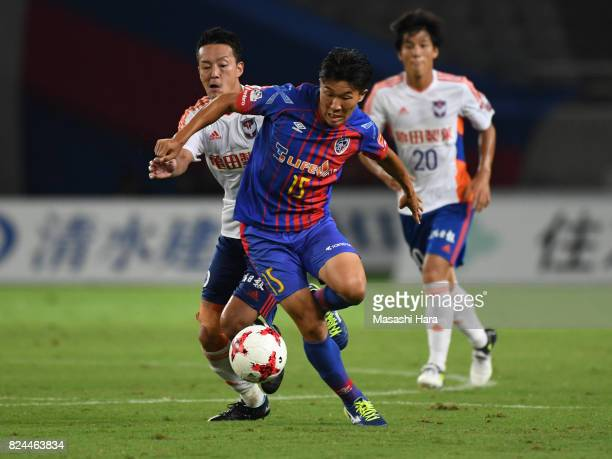Kensuke Nagai of FC Tokyo and Ryota Isomura of Albirex Niigata compete for the ball during the JLeague J1 match between FC Tokyo and Albirex Niigata...