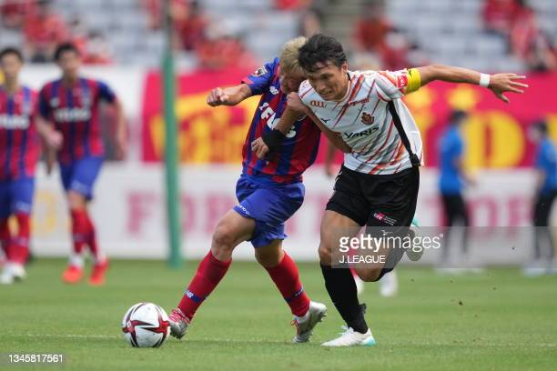 Kensuke NAGAI of FC Tokyo and Shinnosuke NAKATANI of Nagoya Grampus battle for the ball during the J.League Levain Cup Semi Final second leg match...