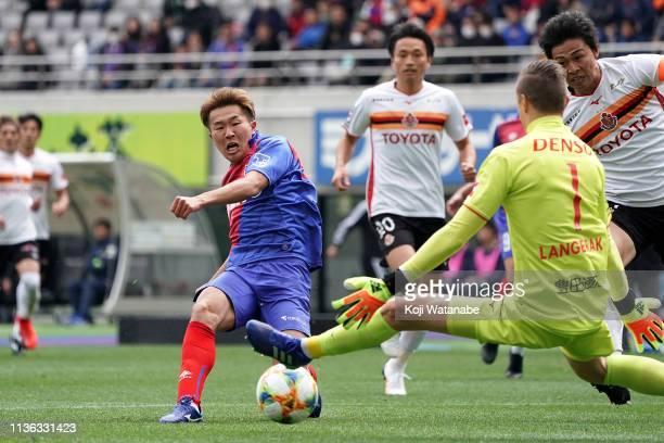 Kensuke Nagai of FC Tokyo scores first goal during the JLeague J1 match between FC Tokyo and Nagoya Grampus at Ajinomoto Stadium on March 17 2019 in...