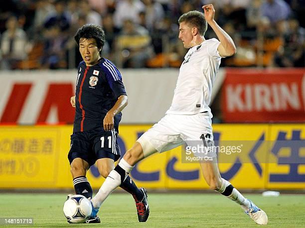 Kensuke Nagai of Japan and Adam Thomas of New Zealand contest the ball during the international friendly match between Japan U23 and New Zealand U23...